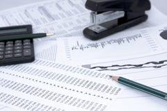 Statistics. Business statistics with pencil and calculator Stock Photos