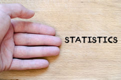 Statistics text concept Stock Photo
