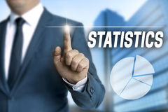 Statistics touchscreen is operated by businessman Royalty Free Stock Photography