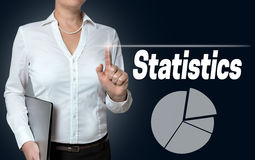 Statistics touchscreen is operated by businesswoman Royalty Free Stock Images