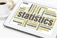Statistics word cloud on tablet Stock Photo