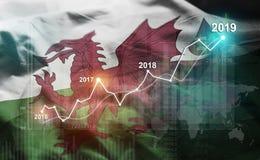Statistique croissante 2019 financier contre le drapeau du Pays de Galles image stock
