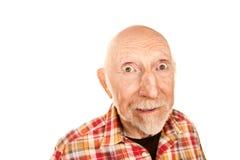 Stattlicher älterer Mann mit überraschtem Ausdruck stockbild