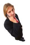 Stattlicher Geschäftsmann auf dem Handy lizenzfreies stockbild