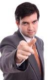 Stattlicher Geschäftsmann, der Finger auf Projektor zeigt Stockbilder