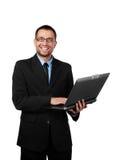 Stattlicher Geschäftsmann mit Laptop Lizenzfreies Stockbild