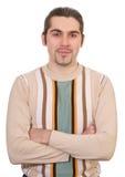 Stattlicher Mann des jungen smiley in der Strickjacke getrennt Stockbilder
