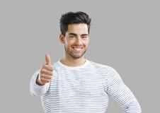 Stattlicher Mann mit den Daumen oben Lizenzfreies Stockbild