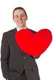 Stattlicher Mann mit geformtem Kissen des roten Inneren Stockfotos
