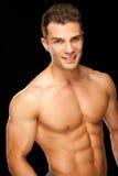 Stattlicher muskulöser junger Mann getrennt auf Schwarzem Lizenzfreie Stockbilder