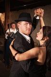 Stattlicher Tango-Tänzer mit Partner Stockfotografie