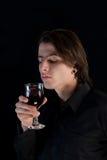 Stattlicher Vampir mit Glas Wein oder Blut Stockbild