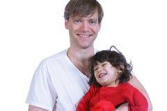 Stattlicher Vater, der sein Kleinkind anhält Lizenzfreie Stockfotografie