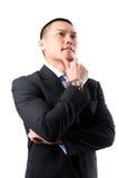 Stattliches junges asiatisches Geschäftsmanndenken Stockbild