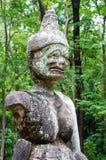 Statua antica del demone in Wat Umong, Tailandia. Fotografia Stock