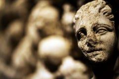 Statua antica del fronte del marmo di età fotografie stock libere da diritti