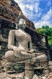 Statua antica di Buddha al parco storico di Sukhothai, tempio di Mahathat thailand Fotografia Stock