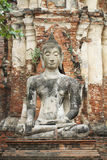 Statua antica di seduta di Buddha, punto di riferimento storico Fotografia Stock