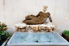 Statua antica di Silenus sopra via del Babuino, Roma Immagine Stock