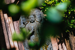 Statua asiatica nel giardino Fotografie Stock