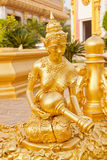 Statua buddista dorata Immagine Stock