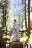 Statua in cimitero Immagine Stock