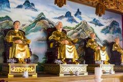 Statua cinese della famiglia] immagini stock