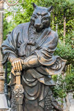 Statua cinese Sik Sik Yuen Wong Tai Sin Temple Kowlo del cane dello zodiaco immagine stock