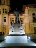 Statua con uno scritto Fotografia Stock