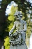 Statua del bambino Immagini Stock