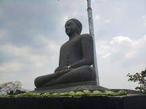 Statua del granito di Lord Buddha immagini stock