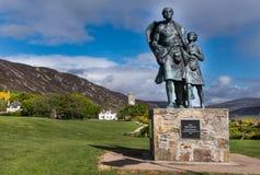 Statua dell'emigrante, lato maschio, a Helmsdale, la Scozia Fotografia Stock
