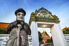 Statua dell'uomo (portiere) al tempio di Wat Pho nelle attrazioni turistiche di Bangkok, del punto di riferimento e di no. 1 in Ta Fotografia Stock