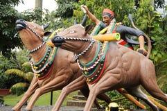 Statua della corsa della mucca Fotografie Stock