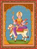 Statua della dea indiana Maha Gauri una dell'avatar da Navadurga con il fondo floreale d'annata della struttura fotografia stock