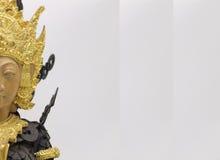Statua di Bali fatta delle monete antiche Fotografia Stock