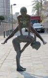 Statua di bronzo nella via Immagini Stock