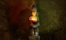 Statua di Buddha con la candela Fotografie Stock