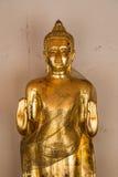 Statua di Buddha nel colore dorato Fotografie Stock Libere da Diritti