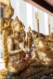 Statua di Buddha in varie posizioni dentro il tempio immagini stock libere da diritti