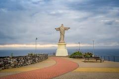 Statua di Cristo Rei in Ponto Garajau, isola del Madera Immagini Stock Libere da Diritti
