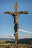 Statua di Gesù sull'incrocio Fotografie Stock Libere da Diritti