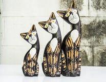 Statua di legno dei gatti Immagini Stock