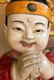 Statua di legno di buddismo asiatico fotografia stock