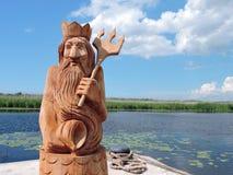 Statua di legno di Nettuno fotografia stock libera da diritti