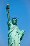Statua di libertà & del tramonto di New York City Immagini Stock