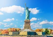 Statua di libertà & del tramonto di New York City Fotografia Stock