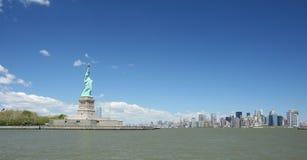 Statua di libertà e di NYC Fotografia Stock