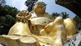 Statua di pietra di Buddha, della divinità, dell'animale sacro e della creatura fotografia stock