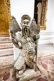 Statua di pietra cinese del guardiano in Wat Pho Buddhist Temple Bangkok Fotografie Stock